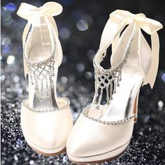 Wedding shoes or prom shoes white or ivory gorgeous with crystals and satin bow -  visit the outlets at Brides book for more great deals from retailers from around the globe at http://www.brides-book.com