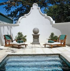 Enclosed terrace with steps leading down into the swimming pool...