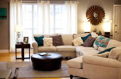 Beautiful colors:  brown, gray, off white, and teal...definitely need to add some blue or teal to the living room!