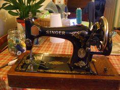 THE LEGEND Vintage Singer hand crank sewing machine.  Mom's was identical!!  GL