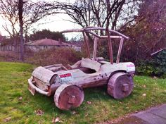 I took this PIC while on a bike ride in kirkland, WA.  It's a full size Fred Flintstone car made of wood.  They wanted $1,200 for it.