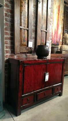 """Mongolian and Chinese pieces fuse to create this impacting statement. The buffet from 1940s Shanxi China is solid poplar and features a cabinet space with one shelf and three drawers beneath 34"""" H, 45"""" W, 16"""" D. It is accented with a set of original hand painted poplar doors from early 20th century Mongolia 67"""" H 16"""" W-$450 each and a hand carved bowl-$50."""