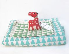 Silk screen printed baby rattle & quilts. www.normadot.com www.normadot.etsy.com