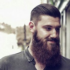 One of the top beard styles 2015 is full and groomed facial hair. Check out this long beard with slick hair and an undercut for a killer combination.