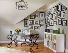 Family photos and a beautiful desk shape this corner home office [From: Emily Followill Photography / Kandrac and Kole Interior Designs]
