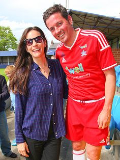 Liv Tyler spiced up a simple plaid top with funky cat-eye sunnies at a celebrity soccer match!