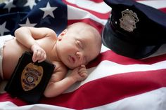 Newborn photo of my youngest son with his great grandfathers police items. He was named after his great grandfather