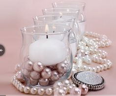 Centerpiece with pearls and a candle in our other vases