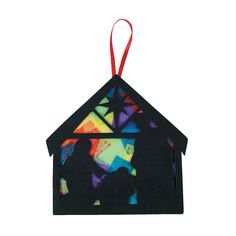 Nativity ornament - tissue paper, foam (or felt, cardboard?) silhouette with acetate core.  Other designs include wreaths, bells - use up acetate sheets.