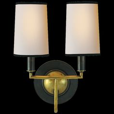 Simple double wall sconce in dark bronze finish with brass accents and creamy shades