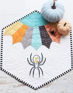 We have the perfect Halloween project for you to create this weekend! Check out this beautiful mini quilt by Bev of Flamingo Toes. It features a sweet floral spider and her colorful Dresden spiderweb. Visit the link in bio for project instructions. Halloween Quilts, Halloween Projects, Happy Halloween, Embroidery Stitches Tutorial, Embroidery Patterns Free, Embroidery Designs, Couture Pour Halloween, Mini Quilt Patterns, Scarf Patterns