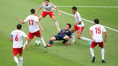 BELO HORIZONTE, BRAZIL - JUNE 22: Shinji Okazaki of Japan fights for the ball against Jesus Zavala, Hiram Mier and Diego Reyes Rosales of Mexico during the FIFA Confederations Cup Brazil 2013 Group A match between Japan and Mexico at Estadio Mineirao on June 22, 2013 in Belo Horizonte, Brazil. (Photo by Friedemann Vogel - FIFA/FIFA via Getty Images)