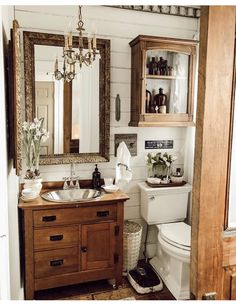 """This half bath downstaires used to be half the size it is now. When the plumber was here working, he said """"I need to know what vanity you… Bathroom Cupboards, Bathroom Renos, Small Bathroom, Master Bathroom, Apothecary Bathroom, Apothecary Decor, Antique Bathroom Decor, Vintage Bathroom Cabinet, Apothecary Bottles"""