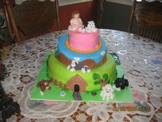 My daughters 7th birthay cake. A dog for each year