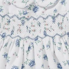 hand-smocked, floral print baby dress from John Lewis