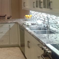 This Arctic Strip White & Gray Stone and Glass Wall Tile compliments the various colours of the kitchen perfectly.