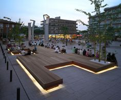 Harris Isola Bench by Metalco - serves as a gathering place in a town square