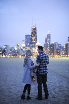 Chicago engagement pic - prob don't NEED the Champagne but would love to have a skyline shot. Love that they're kind of facing the city & the way it glows
