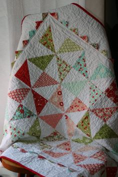 Bliss fabric and prairie points hst quilt.  Pattern on Moda Bake Shop