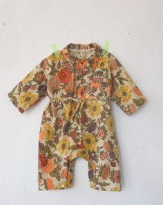Wolfechild botanic print mechanic suit. Very cute!