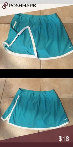 Nike jogging skort Worn once. In excellent condition. Very cute color. Shorts attached underneath. Pet/smoke free home Nike Skirts Mini