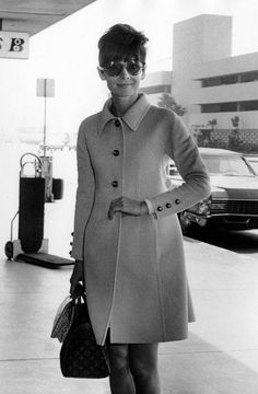 Audrey in 1968: Classic trench and Louis Vuitton bag.