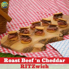 When you're invited to a picnic, it's only polite to take our Roast Beef 'n Cheddar RITZwiches along with you. Place sharp cheddar cheese on all of the RITZ Roasted Vegetable Crackers and deli roast beef on half of them. Place them in the oven until all the cheese is nice and melted. Spoon horseradish on top of the roast beef and cover with the remaining cheese-covered RITZ Crackers, cheese sides down. Voila! A full and fresh spin on a classic combination!
