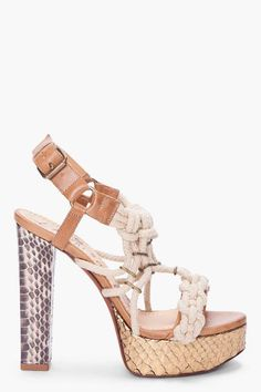 Lanvin Tan Python Cord High Heels - Chunky high heeled python sandals in tan. Crisscrossing beige cord straps with knot details and gold tone hardware. Gold tone pin buckle closure at ankle. Prism heel in textured dark brown and ivory python print. Metallic gold python print at platform. Tone on tone stitching. Approx 5 heel. 1.5 platform.