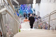 Bride walking to groom at The New Children's Museam