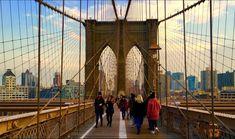 Visitors stroll along the Brooklyn Bridge's bike and pedestrian lanes.