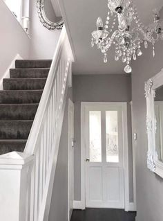 Narrow white hallway in 2019 hallway lighting ideas дизайн д Entrance Hall Decor, House Entrance, Hall Way Decor, Small Entrance Halls, Hallway Decorations, House Stairs, Carpet Stairs, Grey Stair Carpet, Grey Walls And Carpet