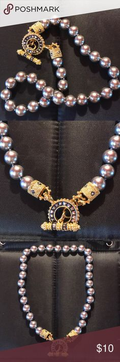 Very Nice Gold Tone Necklace With Shiny Silver Very nice beaded necklace! Pretty gold tone with shiny Silver/grayish beads Jewelry Necklaces