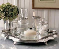 The silver tray with the glass containers look lovely. Could be used in many rooms & ways, such as wine & glasses on a silver tray.