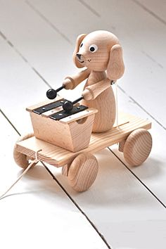 wooden dog with xylophone. available now!