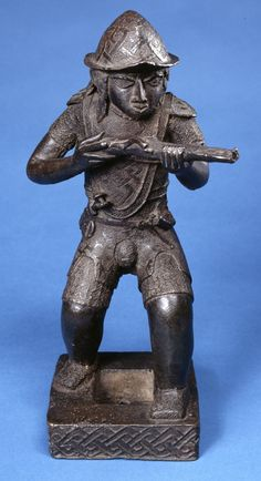 Figures of Europeans such as this Portuguese soldier were kept on royal altars or on the roof of the royal palace in Benin city. The Portuguese were represented in Benin art in various forms. Their arrival by sea and the bringing of luxury goods enabled the Portuguese travellers to be incorporated into Benin ideas associated with the god Olokun, ruler of the sea and provider of wealth.
