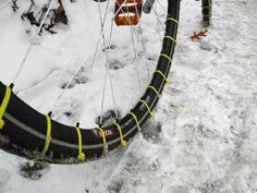 Put Zip Ties on bike tires for traction in snow and ice.