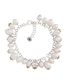 Give your look an on-trend, feminine feel with this Pearl Bracelet from the Sterling Silver Collection. Its ladylike accents make it the perfect finishing touch to the season's breezy silhouettes and lacy layers.