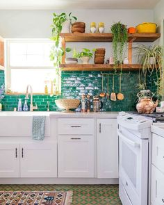I am taking over in celebration of the launch of my latest book, The New Bohemians Handook! White cabinets and shiny surfaces that reflect light, like our glazed backsplash, helps to amplify light in any kitchen and energizes the whole space. Photo by @