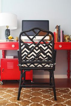 Gorgeous office with Ballard Designs Macau chair in black with white & black zigzag chevron cushions, glossy red desk with turned legs, gold horse head bookends, red locker, horse head lamp and brown Pottery Barn Moorish Tiles Rug. Bright Painted Furniture, Decor, Red Desk, Chair, Bamboo Chair, Chippendale Chairs, Painted Furniture, Red Rooms, Organizing Your Home