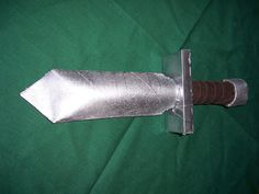 Make a cardboard short sword...Sword of the Spirit