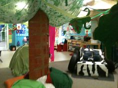 We covered the roof in brown mesh and then made vines using crepe paper streamers. As we explored life in the jungle our room evolved!