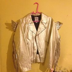 Jeremy Scott Gold Fringe Motorcycle Jacket Gold fringed motorcycle jacket by Jeremy Scott for Adidas. Features gold wings attached to the back. Item is in perfect condition with no flaws. Item is unisex however it is in a men's small Jeremy Scott Jackets & Coats