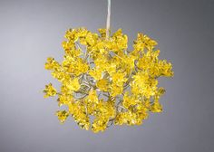 This hanging lamp filled with handmade golden flowers from Etsy will brighten up a dark room.