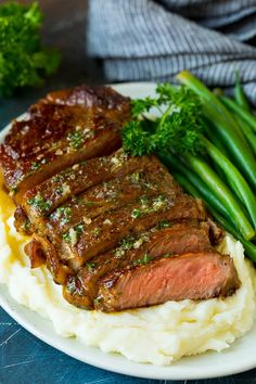 This sirloin steak is seared to golden brown perfection, then topped with garlic and herb butter. A simple, yet totally satisfying way to enjoy steak that's easy enough for an everyday meal, yet elegant enough for company. Top Sirloin Steak Recipe, Sirloin Recipes, Sirloin Steaks, Beef Recipes, Beef Meals, Steak Dinner Recipes, Grilled Steak Recipes, Healthy Dinner Recipes, Healthy Food
