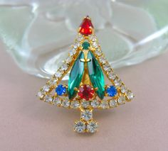 Petite Christmas tree brooch / pin with prong set, faceted multi color…