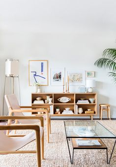 Coffee table, neutral chairs, minimal color scheme & art inspo