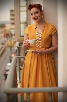 An elegant sunshine yellowvintage style swing dress, theAllegra Dress is the perfect way to add some old fashioned glamour to your daytime wardrobe. By Miss Candyfloss at UK stockists, Deadly is the Female.