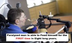 A paralyzed man feeds himself for the first time in eight years after doctors implanted sensors in his brain that sent signals to his arm.