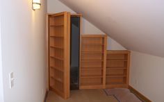 DIY Rolling Bookcases  Carla Schlatter Ellis had a rolling bookcase wall built while her home was under construction.