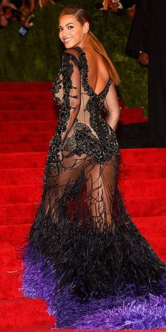 "Looks like Beyonce is saying, ""Kiss my butt!"" to New York society's upper crust at the Met Gala Ball, on the red carpet.  People Stylewatch."